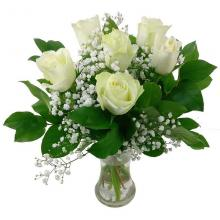 6 white roses in a glass vase