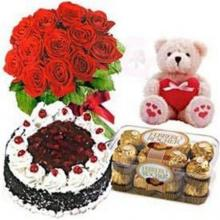 12 Red Roses Bouquet, 16 Ferrero Chocolates, 1 kg Black Forest cake and Free Teddy Bear